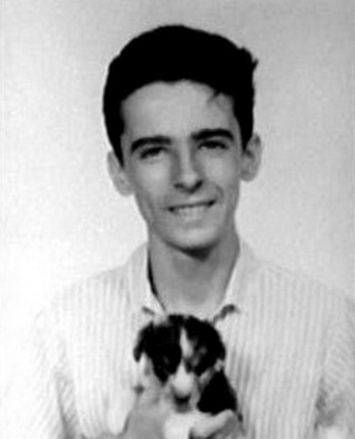 Young Alice Cooper holding a puppy picture