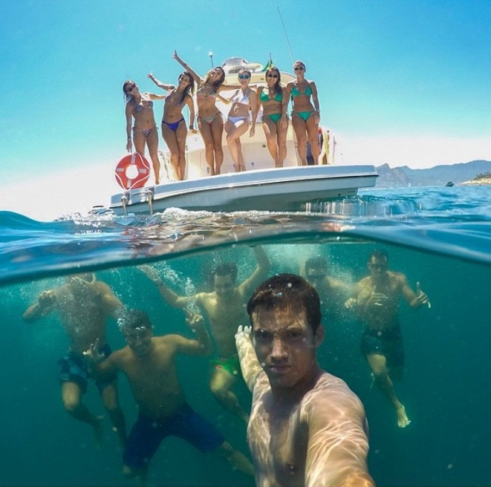 Selfie with people under and above water