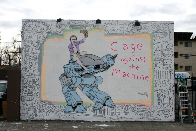 Cage against the Machine, by Hanksy