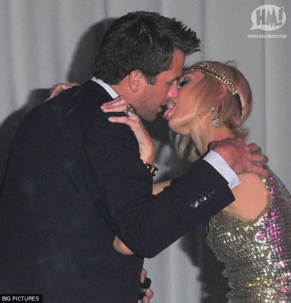 Paris Hilton dog licking kiss at Cannes