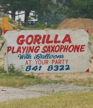 Gorilla playng saxophone with balloons