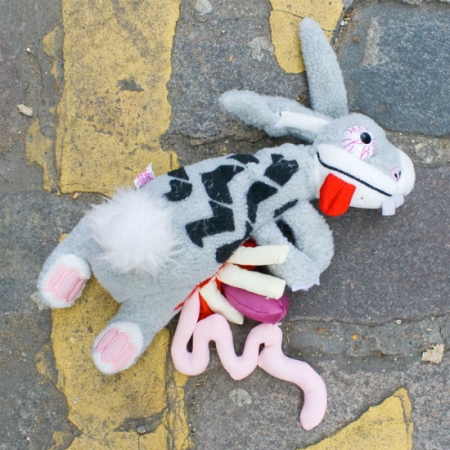 Plush rabbit roadkill